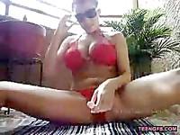 Busty Babe Toys On Balcony