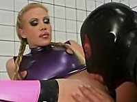 Hot blond in latex and rubber