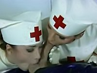 Latex nurses treat a rubber gas mask guy