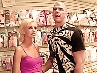 Blonde pornstar in the adult video store