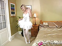 Blonde in white wears sexy pantyhose