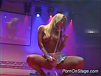 Blonde bombshell takes dildo on stage