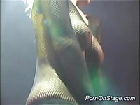 Busty brunette goes wild on stage