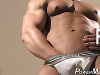 Fully nude bodybuilders pose and play
