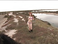 Redhead girl playing outdoors