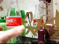 Stuffing a soda bottle in her twat